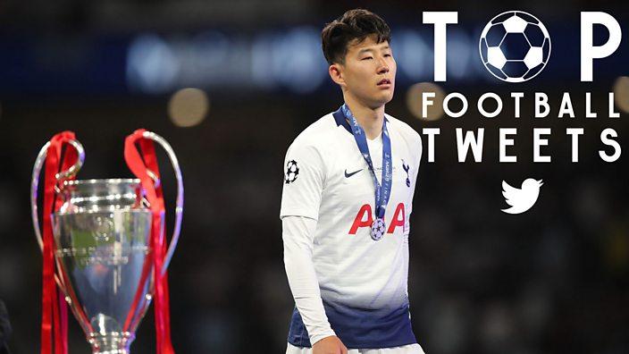 Son of Tottenham walks past the Champions League trophy