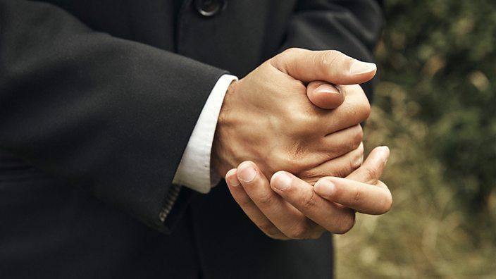 Waleed clasped hands