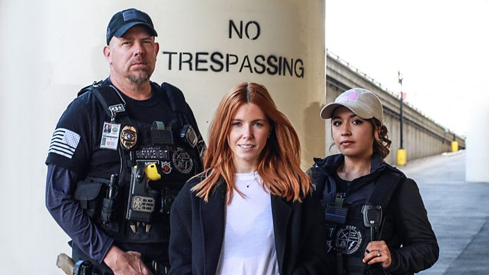 Stacey Dooley stands between two bounty hunters from her latest documentary