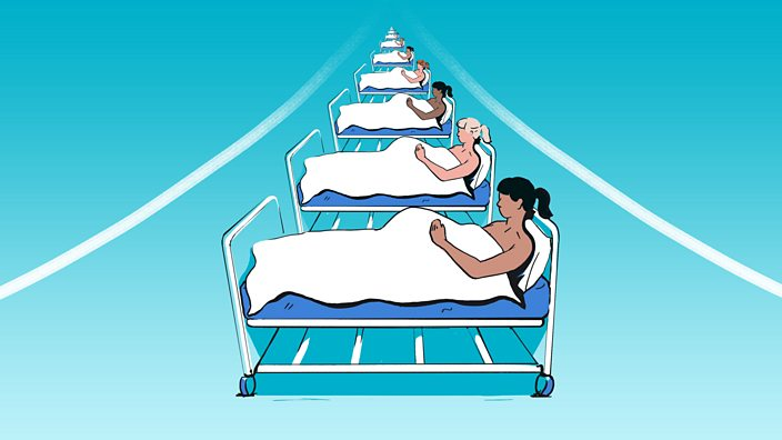 A row of pregnant women lying on hospital beds