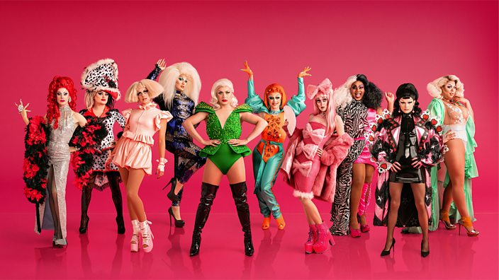 UK drag queen contestants from Ru Paul's Drag Race posing against a pink background