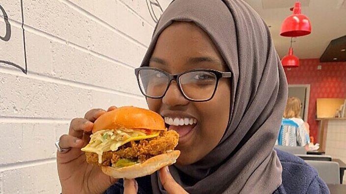 Sumaya eating a vegan burger