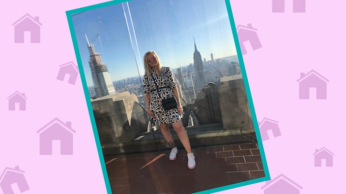 Emma Lumley poses in front of a city skyline