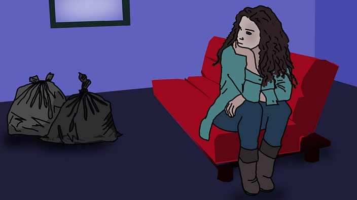 Young woman sat on a sofa bed looking at binbags