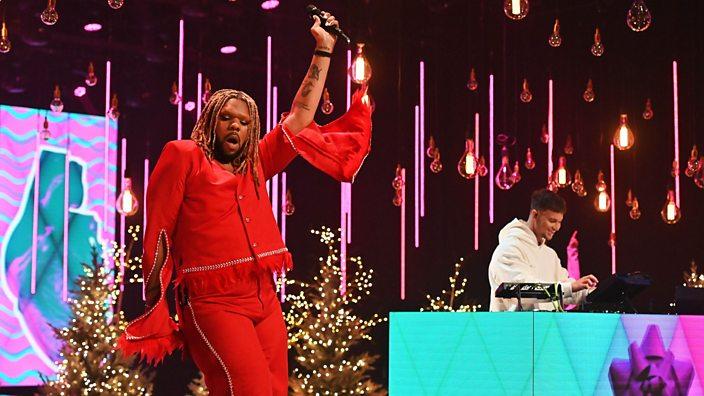 MNEK performing on stage
