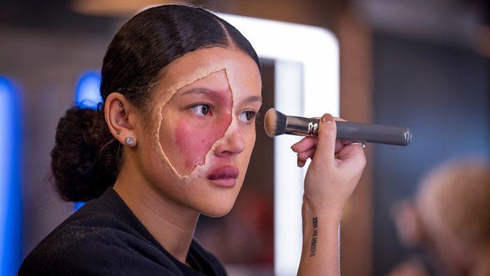 Ryley applying make-up around her birthmark