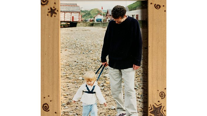 Alex and her dad, when she was little, walking on the beach.