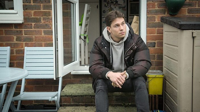 Joey Essex sat on a step thinking.