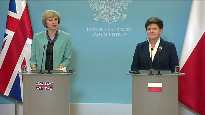 Theresa May 'wants and expects' to protect rights of Poles in UK