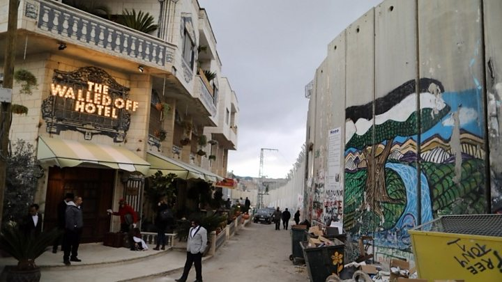 Banksy unveils 'modified nativity' scene in Bethlehem