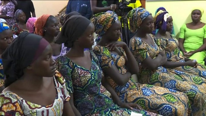 Image result for Nigeria Chibok girls: Freed 82 meet President Buhari