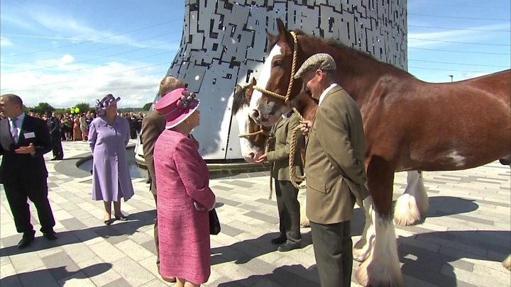 In pics: Queen opens new canal during barge journey to view Kelpies