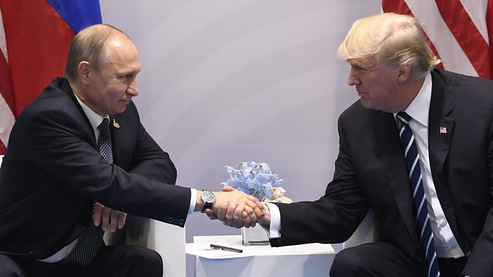 Media captionWhat Trump said of his first, formal meeting with Putin