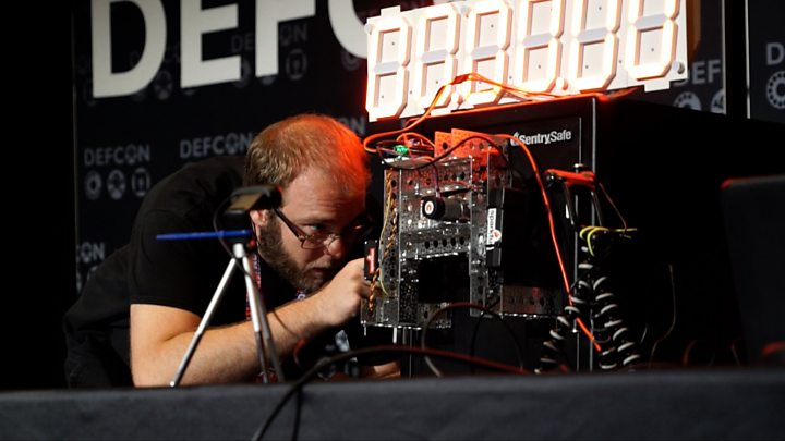 Image result for Robot cracks open safe live on Def Con's stage