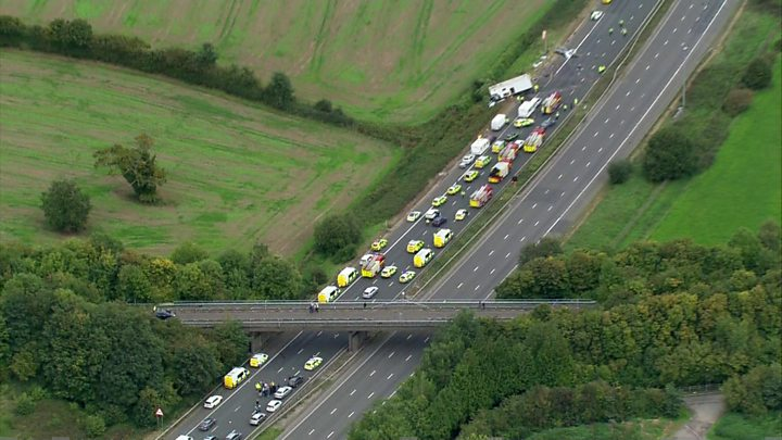 Four killed in M5 pile-up after lorry has 'puncture'
