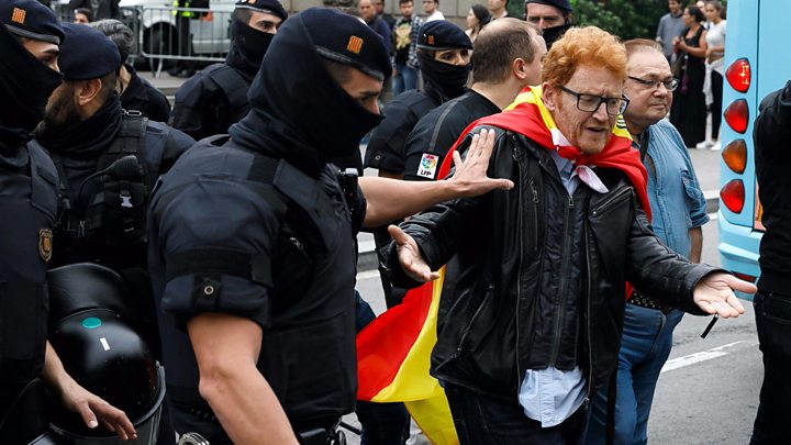 Riot police were seen using batons and kicking people to block voting