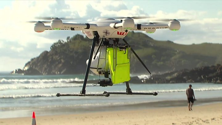 Drone saves swimmers in 'world-first rescue'