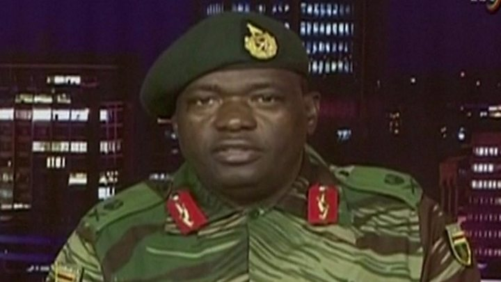 Media playback is unsupported on your device                  Media caption Maj Gen Sibusiso Moyo read out a statement on national TV early on Wednesday