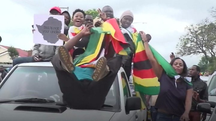 Image result for Zimbabweans rallied to celebrate the army's takeover of the country