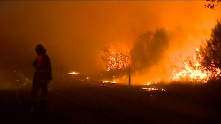 Homes threatened as bushfire burns near southwest Sydney