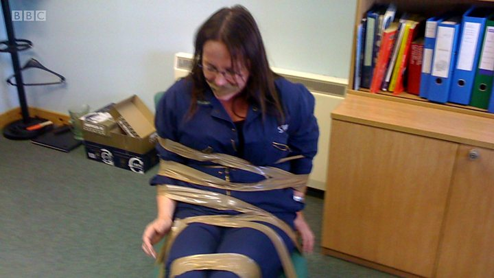Image result for woman taped to chair scotland office