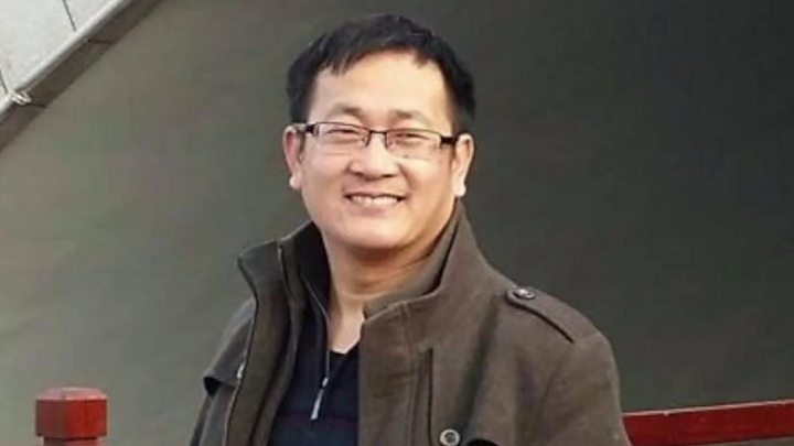 Chinese government critic arrested at his home during live interview