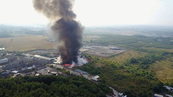 Firefighters battle a rare 'firenado' at plastics factory in the UK