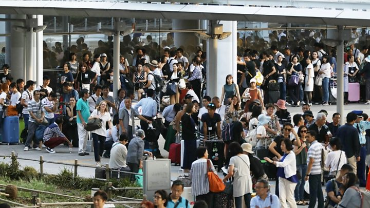 Japan typhoon leads to airport evacuation