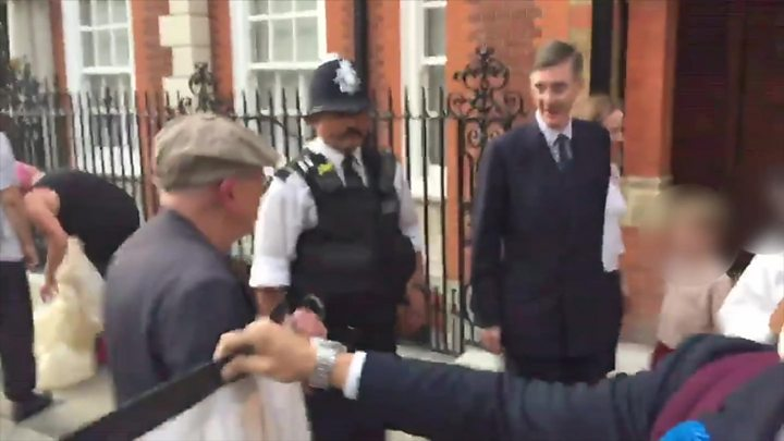Jacob Rees-Mogg brushes off protest outside home - BBC News
