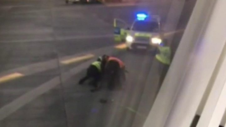 Man moons photographers after being charged with damaging door at Dublin Airport