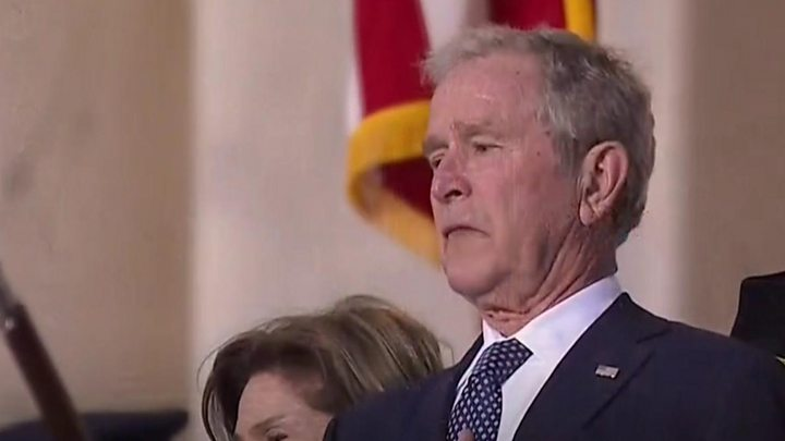 Media playback is unsupported on your device                  Media caption George W Bush struggled to hold back his emotions as his father's coffin passed him