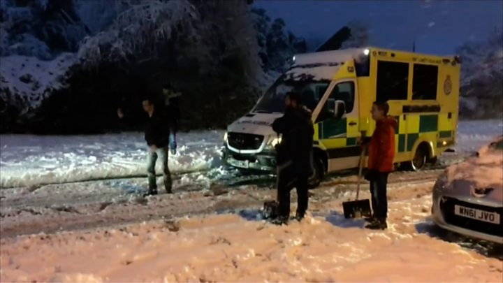 Ambulance rescued on snowy road