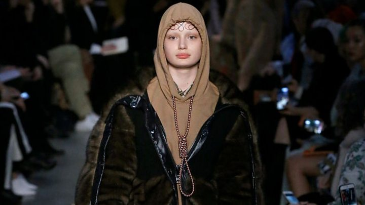 Model stages silent protest on Gucci catwalk over 'straitjacket' designs