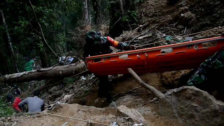 Rescuers use excavator at collapsed Indonesia gold mine