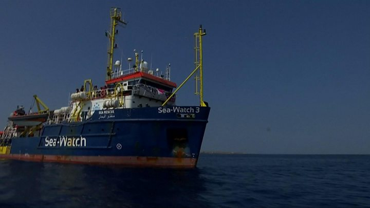 Migrants stranded on rescue ship as it ignores port ban
