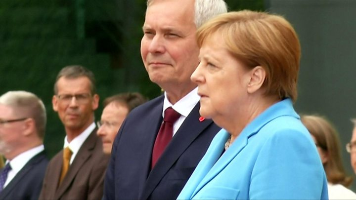 Merkel seen shaking again at public ceremony