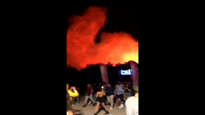 Fans forced to flee music festival as huge fire breaks out