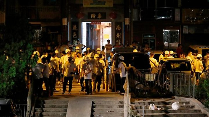 Masked mob storms Yuen Long station
