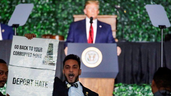 Protester interrupts Trump's democracy speech