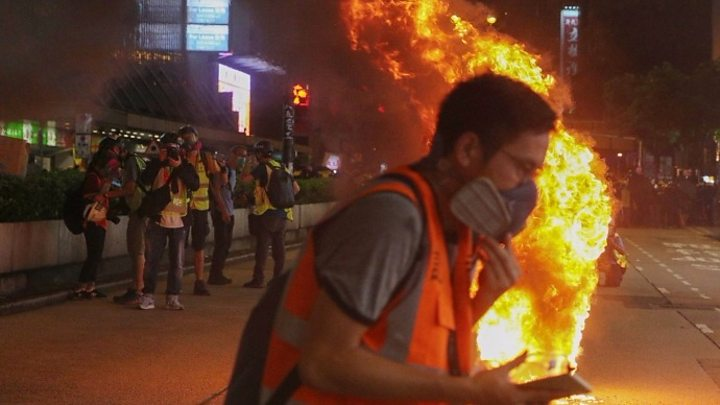 Hong Kong protests: Police and protesters fight running