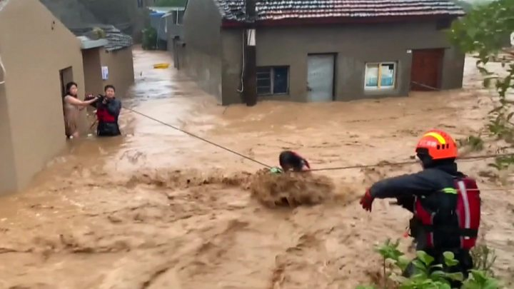 Dramatic rescues as typhoon causes floods in China