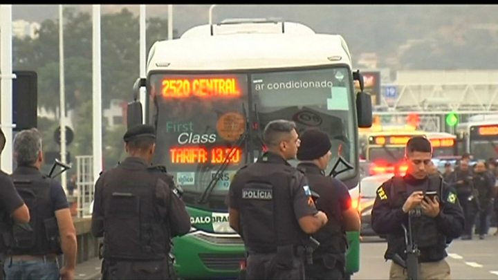 Bus hijacking standoff ends after police shoot suspect