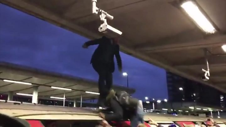 Extinction Rebellion protesters dragged from Tube train roof