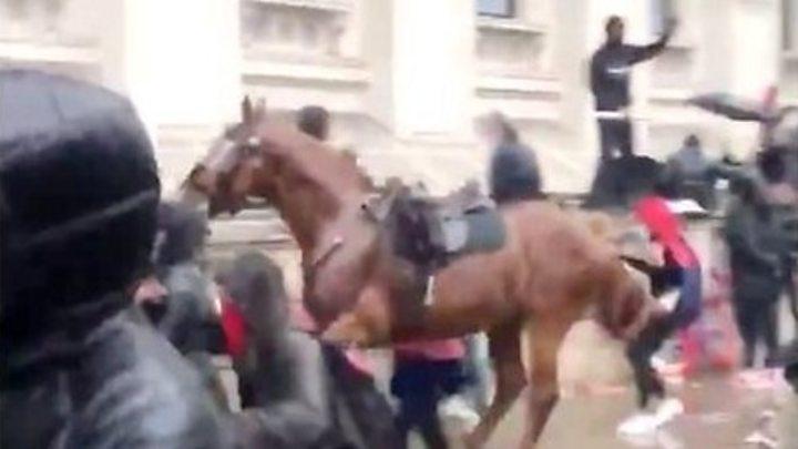 Paris marchers decry racism, far right rallies in London