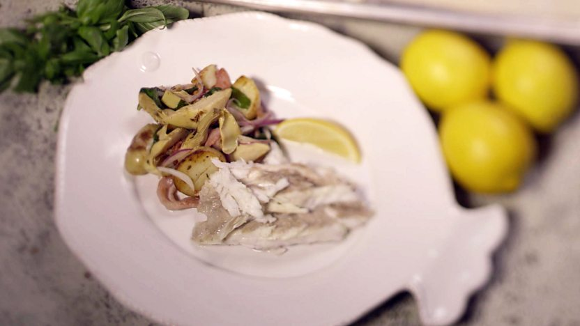 Salt-baked sea bass with warm artichoke and bacon salad