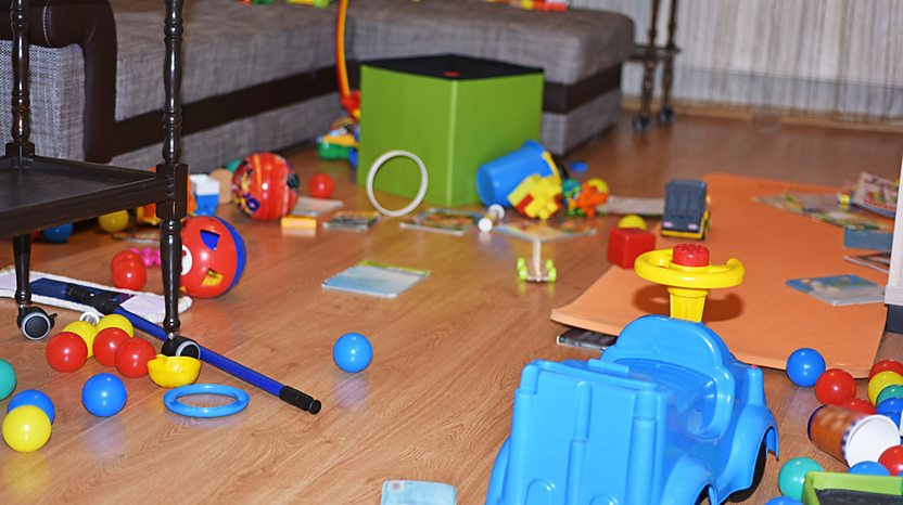 A room full of toys on the floor.