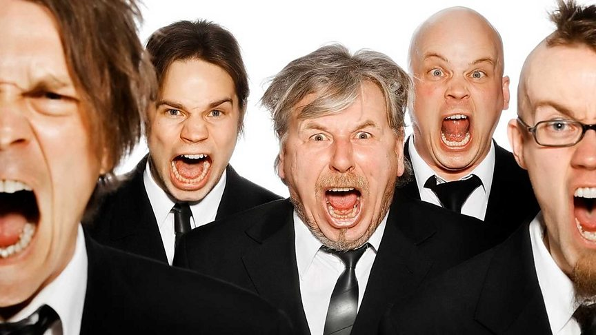 Group of men in suits shouting