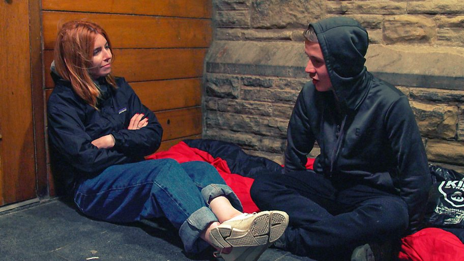 Stacey sits talking to Josh, a young homeless man in Blackpool