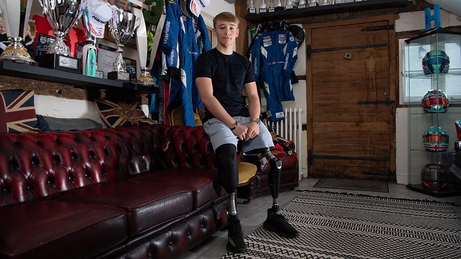 Billy Monger after losing his legs surrounded by trophies
