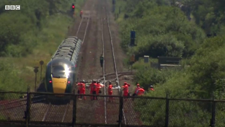 Tributes to two rail workers killed by train near Margam - BBC News
